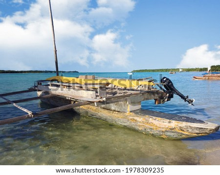 Typical melanesian wooden boat in the Upi bay to reach the Golden bay.