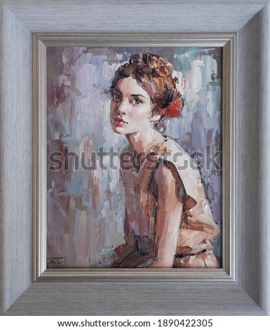 Framed oil painting. Portrait of a girl. The art is done in a realistic manner.