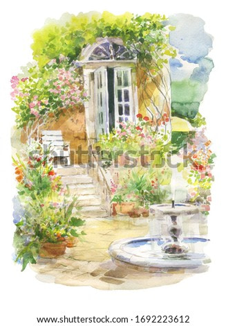 beautiful village garden with cozy house and fountain