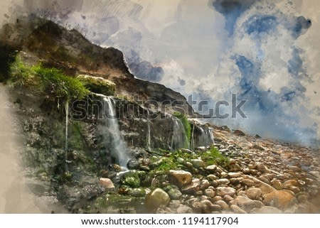 Digital watercolour painting of Landscape image of waterfall flowing onto rocky beach at sunrise