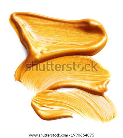 Golden paint strokes isolated on white background