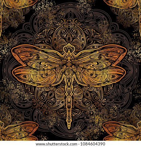 Seamless pattern - exquisite golden ornate stylized dragonfly against the background of the mandala. Spiritual, esoteric, totem symbol. Ethnic tribal patterns with elements of Ar Nouveau and Boho.