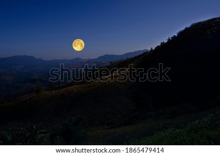 Romantic full moon over the mountains in the evening