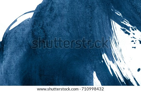 Blue abstract watercolor stroke design on paper