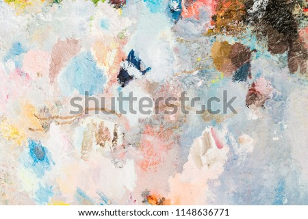 close-up of different colors with oil paint. colored acrylic. the concept of modern art. background image.