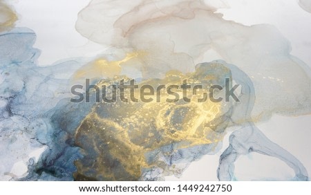 The picture is painted in alcohol ink. Abstraction will perfectly fit into a modern interior. Closeup of the painting. Colorful abstract painting background. Highly-textured oil paint.