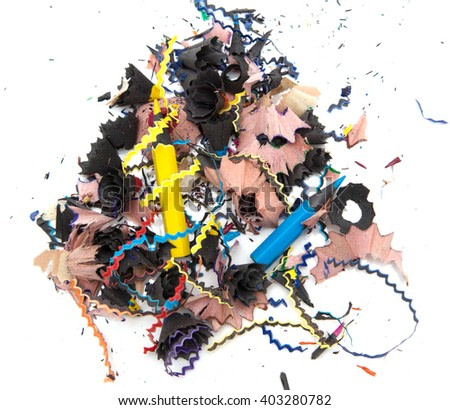 shavings of colored pencils on white background