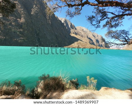 this lagoon is to famous by the color of its water . it's name is llanganuco lagoon . Located in the country of Peru in the province of Huaraz