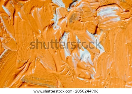 Abstract acrylic and watercolor painting. Canvas background with a paint brush, Orange and white color