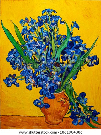 Oil painting on canvas. Vase with irises on a yellow background. Free copy based the famous painting by Vincent Van Gogh.