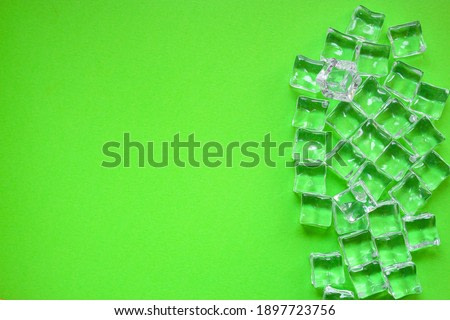 artificial ice plastic pieces transparent acrylic pieces not really cold, optical illusion ready to eat on the table outdoor top view copy space for text food background