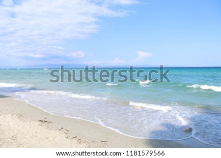 Beautiful Mediterranean sea shore in Greece at summer time. Amazing clear water and wild beach.