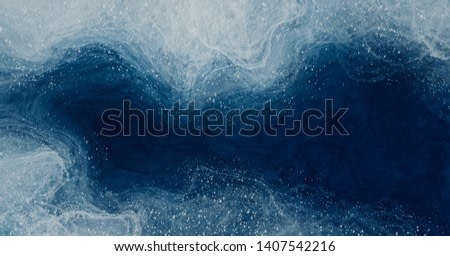 Abstract watercolor paint background navy blue and white flicks with liquid fluid texture for background, banner