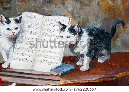 Two little kittens are playing with musical notes. Oil on canvas.