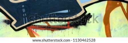 Street art. Abstract background image of a fragment of a colored graffiti painting in dark grey and red tones