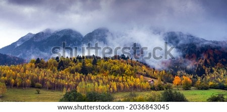 Mountain peaks at dawn with fog.