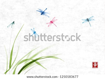 Dragonflies flying over the grass on rice paper background. Traditional oriental ink painting sumi-e, u-sin, go-hua. Hieroglyph - happiness